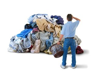 man-with-huge-pile-of-laundry